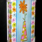 Orange Flower in Vase by Sandy Russell