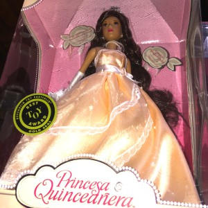 Princess Princesa Quinceanera doll wearing soft orange gown, crown, and jewelry
