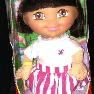 Dora Doll Wearing Pink and White Striped Dress